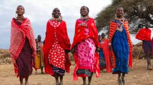 4 brightly dressed African women