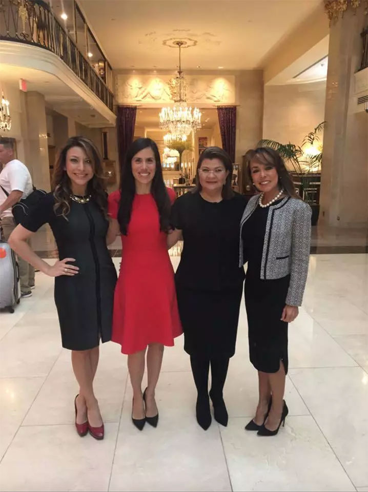 four women business owners standing in white house lobby