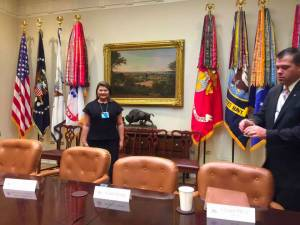 Translation company owner standing in oval office