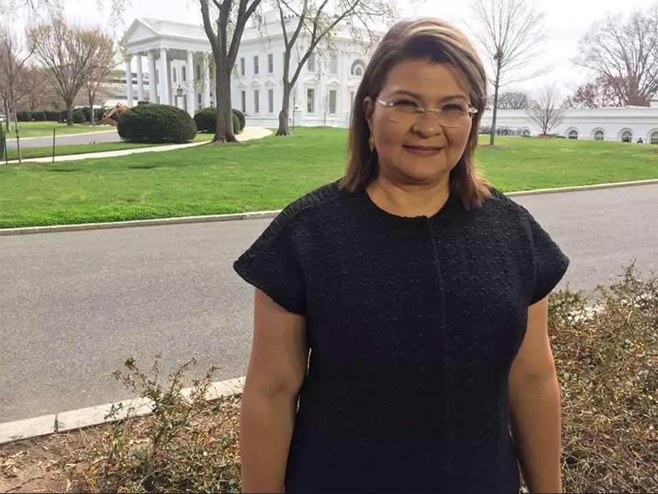Claudia Mirza standing outside of whitehouse
