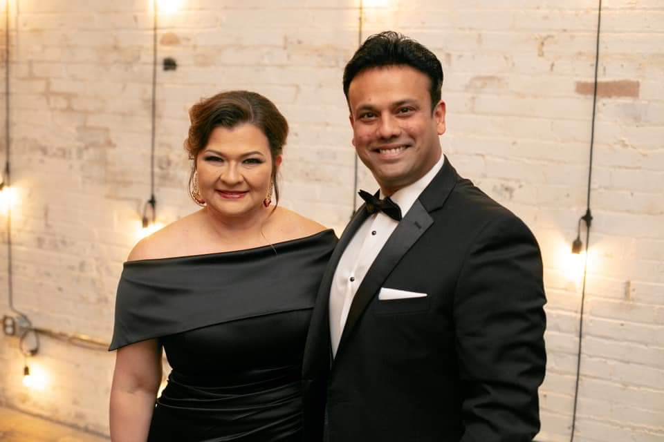 Claudia and Azam in black tie attire