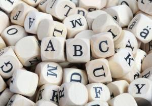 Dice with letters stamped on them