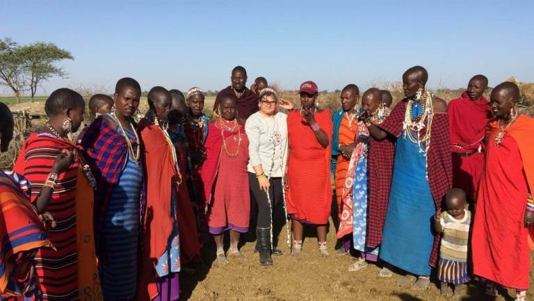 Claudia with group of African people