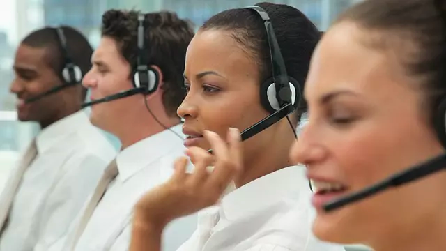 Call Center Representatives Using Headsets Talking on the Phone