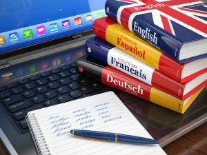 Language books on laptop