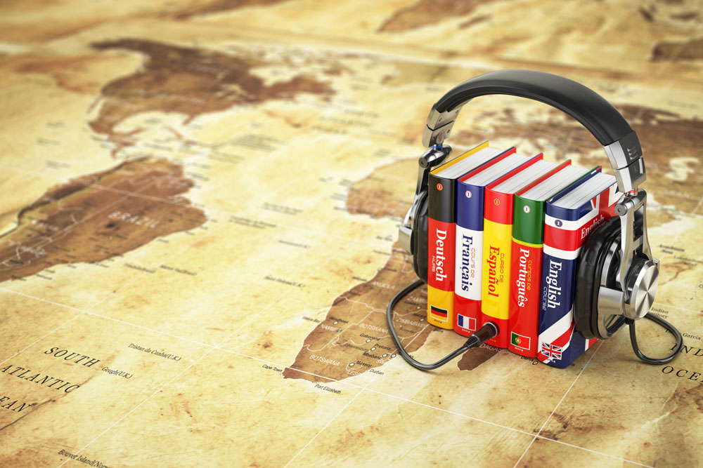 Headphones plugged into language books