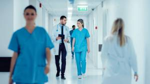 Surgeon and a nurse walking together