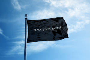 Flag against sky with Black Lives Matter