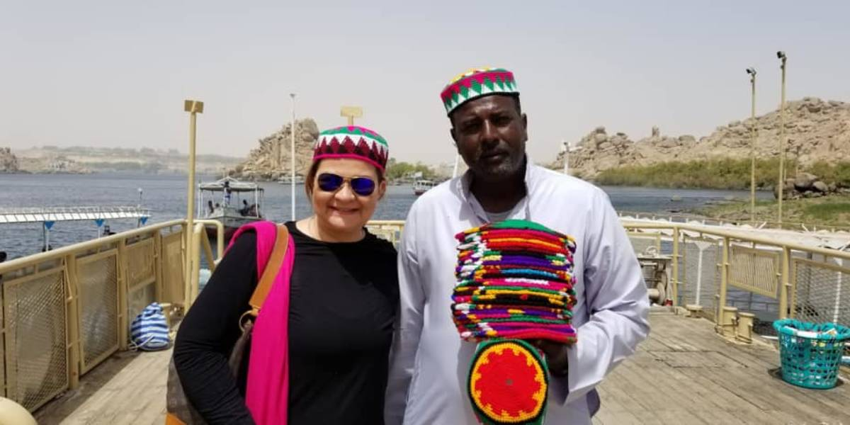 Claudia Mirza with African Shopkeeper in Cairo Egypt