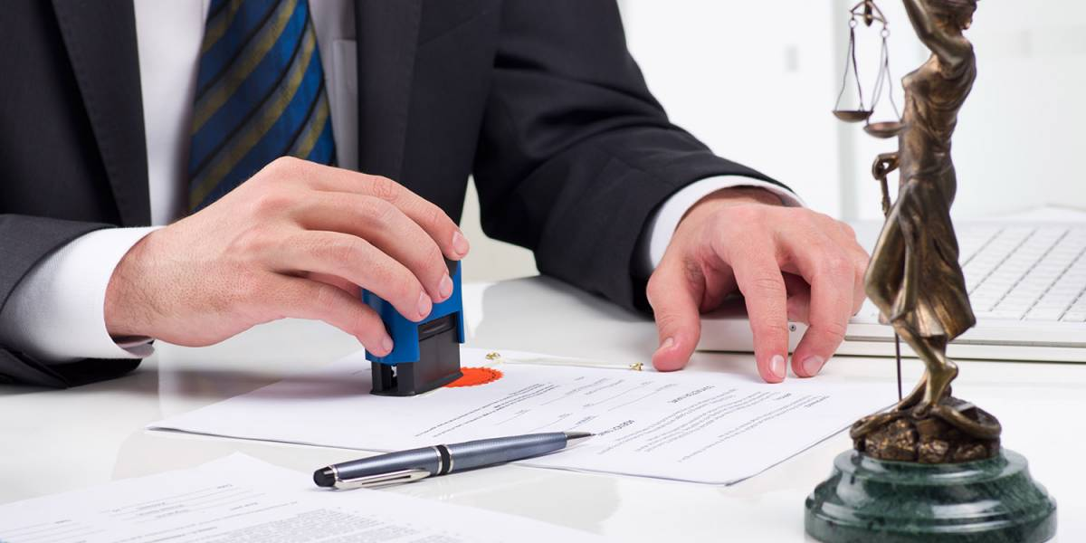 Man Stamping a Legal Document