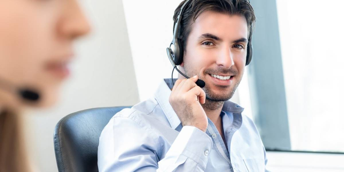 Man in Call Center Wearing Headset