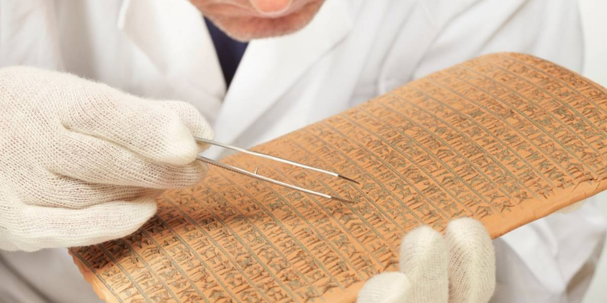 Scientist Examining Cuneiform