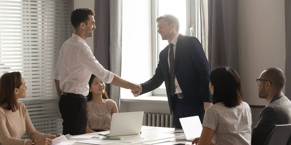 Two Men Shaking Hands in a Business Meeting