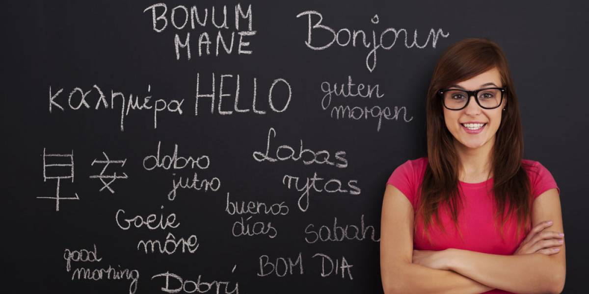 Young woman in front of translations on blackboard