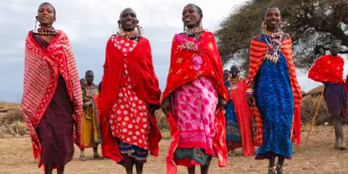 Women Wearing Traditional African Dresses Walking Together