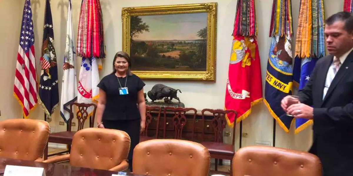 Claudia in White House meeting room