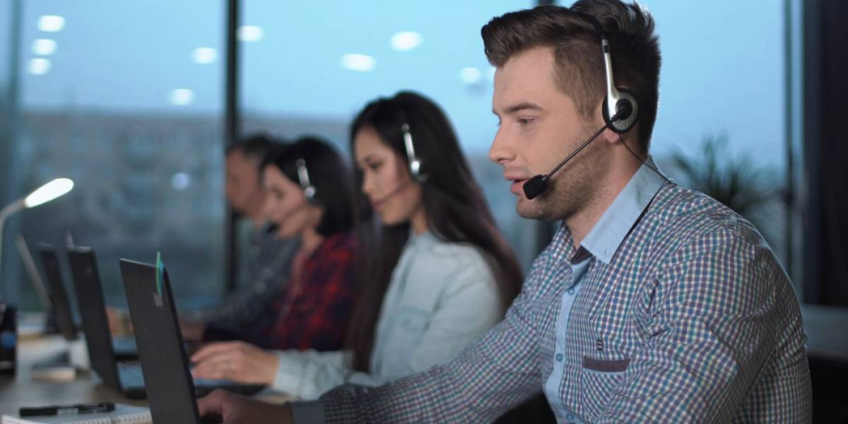 Young man working at a multilingual contact center