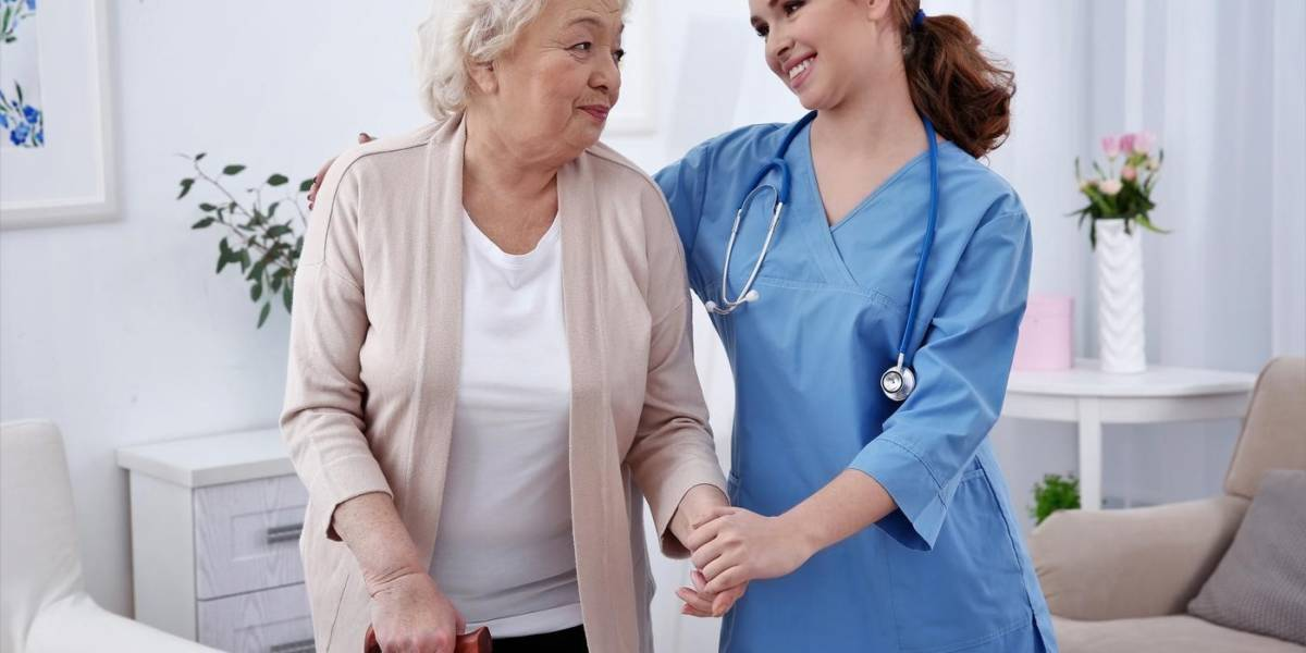 Older woman with a cane holding hands with a smiling nurse