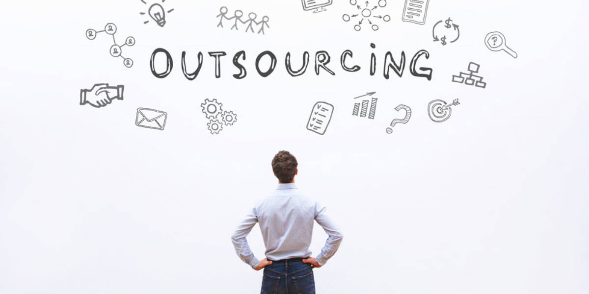 Man standing in front of outsourcing wall mural