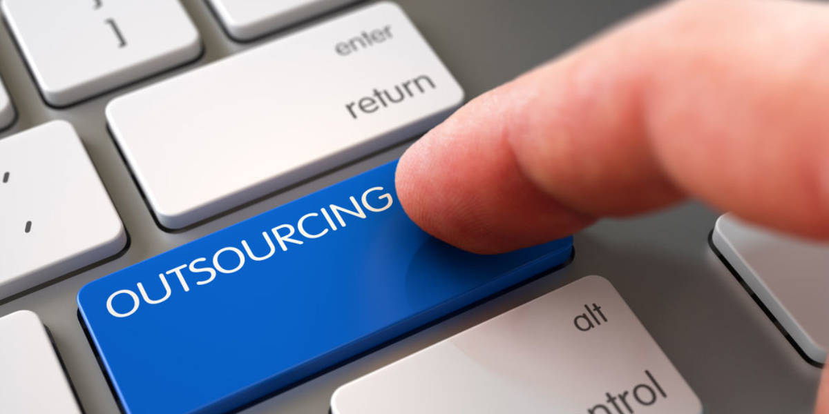 Finger Pushing Outsourcing Button on Keyboard