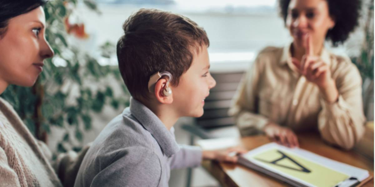 Boy with a hearing aid