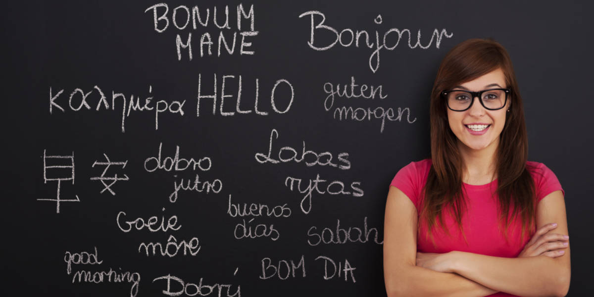 Hello in Different Languages on a Chalkboard with Female Teacher