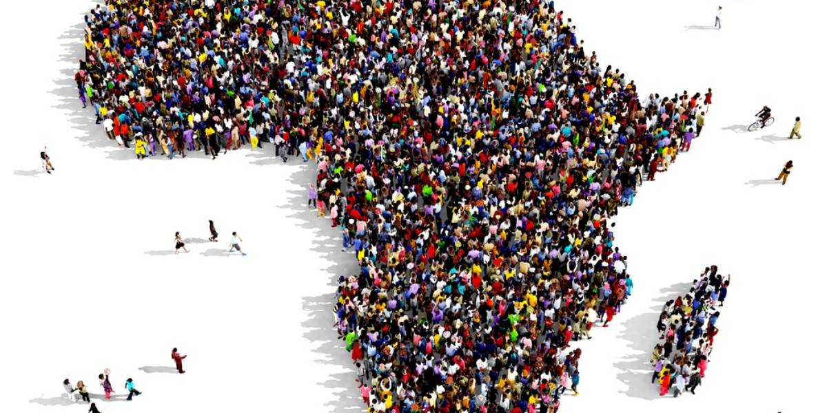 Overhead image of people standing in the shape of African continent