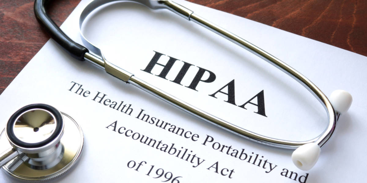 Piece of paper with HIPAA on it and stethoscope