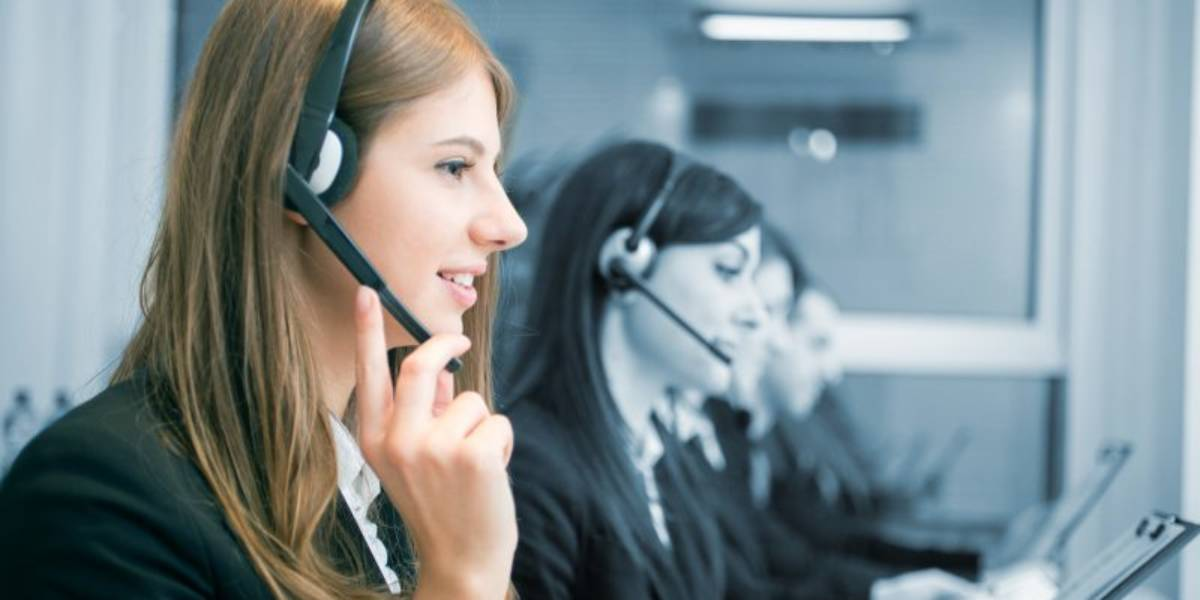 Woman speaking over microphone at call center