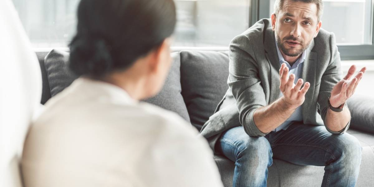 Man on a Couch Speaking to a Therapist
